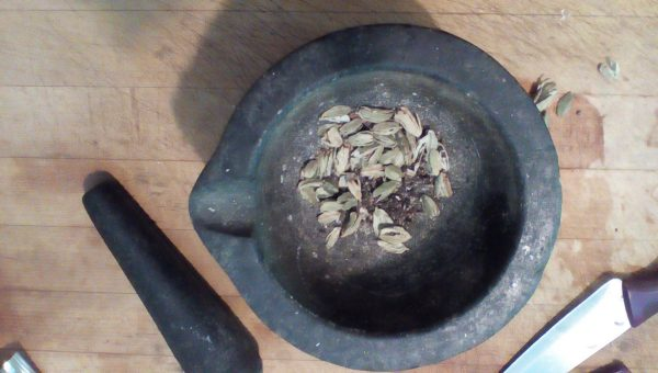 separate the cardamom seeds from the pods