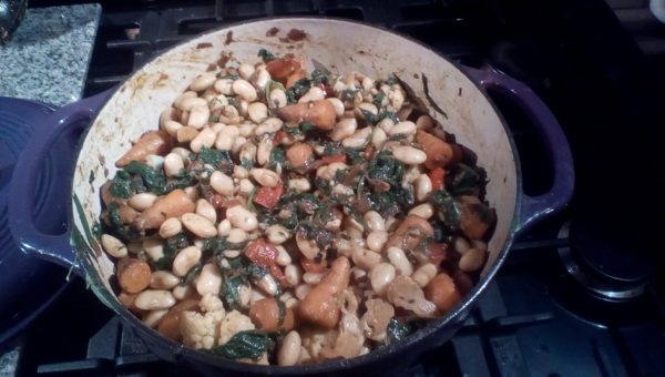 Once the spinach has wilted stir in and add the butter beans and some salt if they were in unsalted water. Replace the lid and heat through until bubbling.