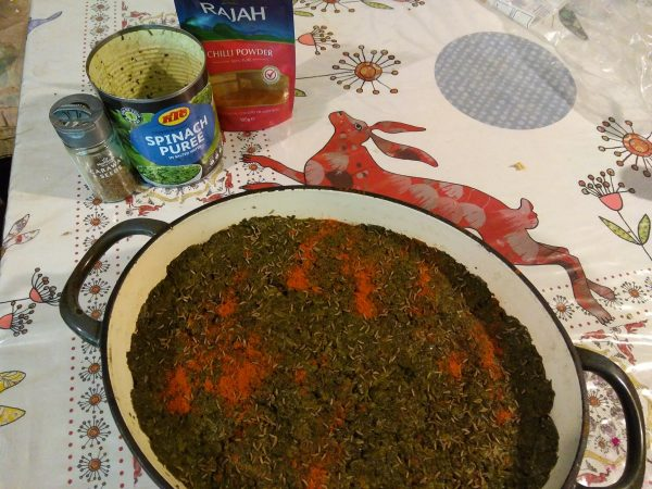 Cover the swedes with a layer of spinach puree and sprinkle it with caraway seeds and chili powder.